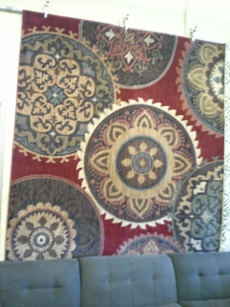 Mohawk 8 x 10 Red Area Rug with Decorative Circle Patterned Accents