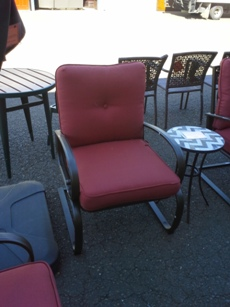 Outdoor Chocolate Metal Chair with Curved Arms & Orange Seat Cushions