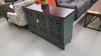 Crestview Distressed Teal Console Cabinet with Cut-Out Accents